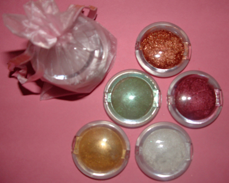 small assortment of mica in flip top pink containers.